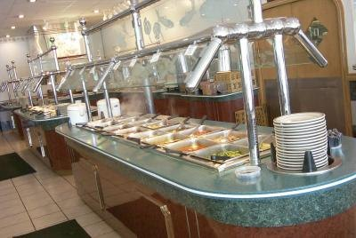A buffet in a restaurant is ready for patrons.