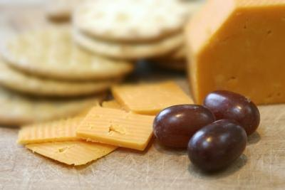 Sliced cheese, crackers and grapes