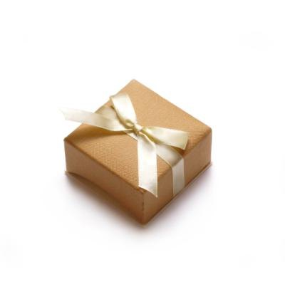 Plain gift with white ribbon.