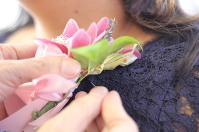 A wrist corsage becomes a traditional corsage.