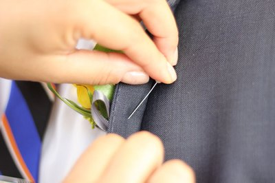 Insert the pin through the back of the lapel.