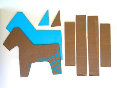 Cut out cardboard to make the form of the donkey.