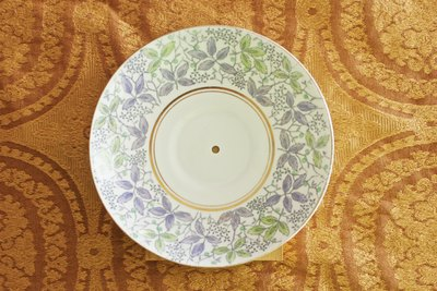Porcelain plate with a hole drilled in the center