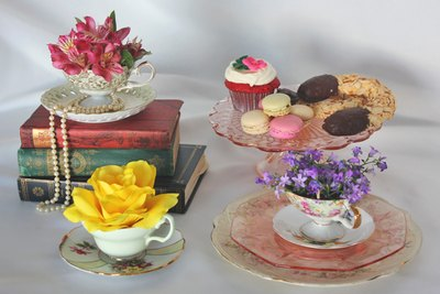 Teacup flower arrangements add vintage flair.