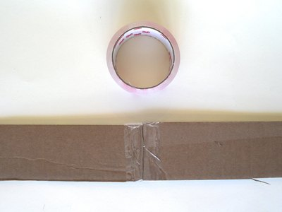 Tape the cardboard strips together.