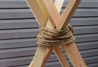 Wrap the rope around the wood.