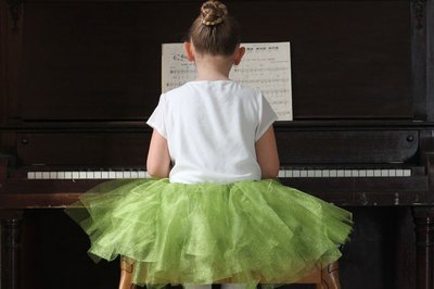 Playing the piano in a tutu