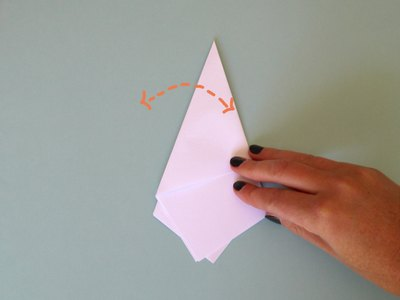 Fold the left corner backwards to form a cone.