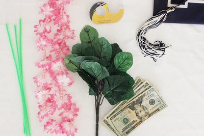 Supplies needed to make a money lei.