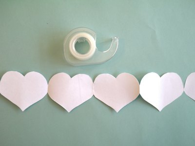 Link the heart chains with tape.