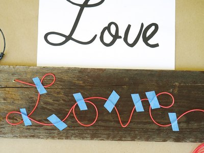 "Spell out the entire word ""Love"" in EL wire."