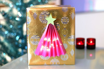 Illuminated Christmas tree gift wrap.