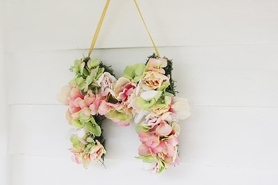 Hang on a wall, incorporate as a centerpiece or place atop a cake.