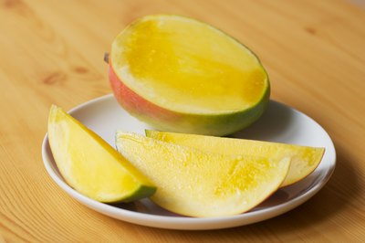 How to tell if a mango is overripe with pictures ehow skin turns red or orange the mango is ripe and juicy over ripe fruit will be mushy and sour so it is important to know when the fruit is good to eat ccuart Gallery