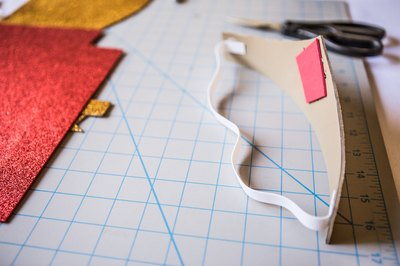 Glue the piece of elastic to the second side.