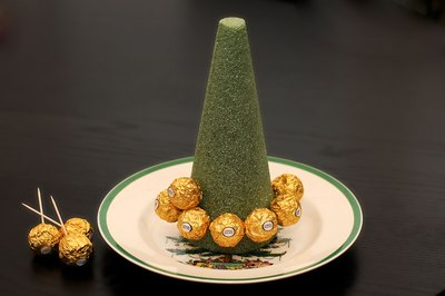 Start With A Bottom Ring Then Add Another Of Truffles Above That Continue Until The Entire Cone Or Tree Is Covered