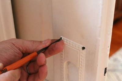 It may take some wiggling and twisting, but screws will come free from painted metal fairly easily.