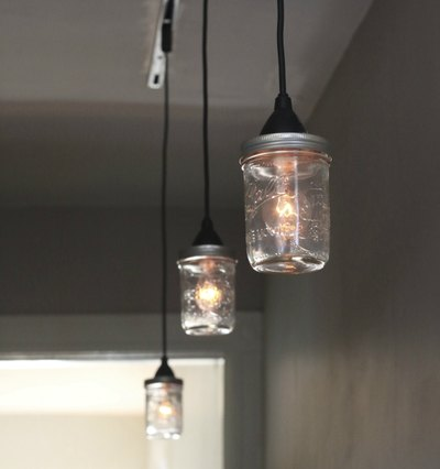 Edison style light bulbs give off an industrial feel when paired with the mason jar light shades.