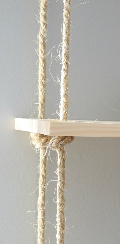 Thread the ropes through one plank and secure with knots.