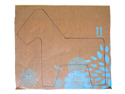 Draw a donkey shape onto flat cardboard pieces.