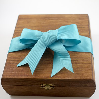 Dress up a wooden box with a beautiful bow.