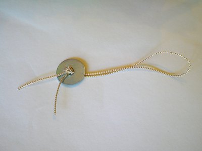 Thread cord through the washer and secure with a thick knot.