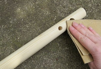 Sand holes to remove any splinters.