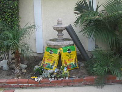 Supplies for fountain garden planter.