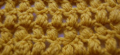 A swatch of puff stitches worked in rows.