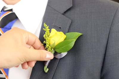 Boutonnieres are traditionally worn on the left jacket lapel.
