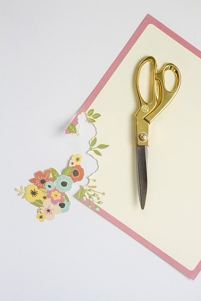 Use sharp scissors to carefully cut out the details that will later be added to the tray.
