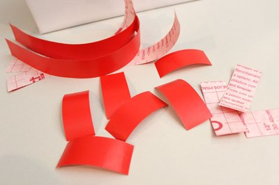 Cut red contact paper into strips.