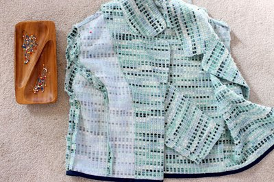 Pin and sew the sleeves into the armhole of the jacket.