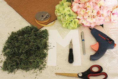 Supplies needed to make a floral monogram.