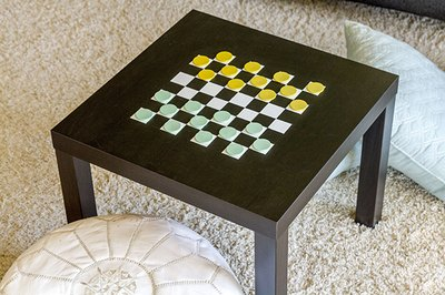 Use masking tape and paint to create a DIY checkerboard game table.