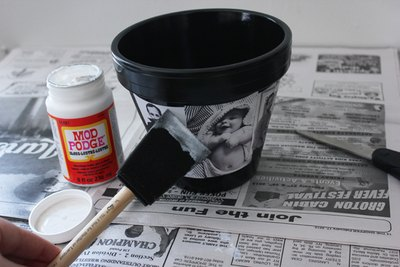 Apply a thin layer of Mod Podge to flower pot.