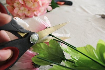 Trim the stems off the silk flowers.
