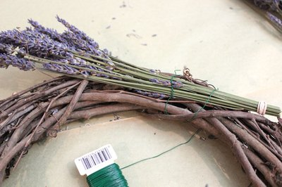 Wrap the first lavender bunch around the wreath.