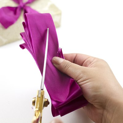 Cut diagonal slits into the ribbon.