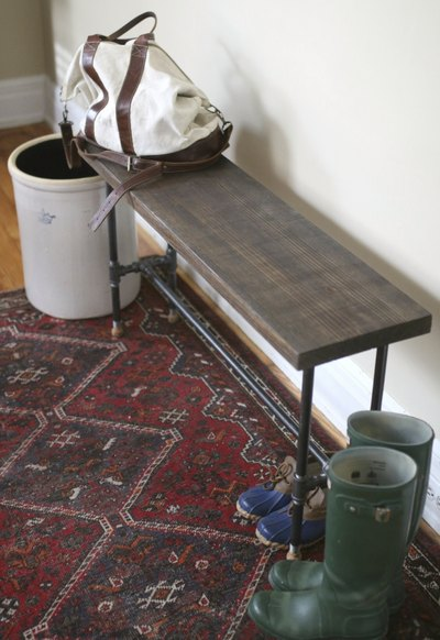 Use the bench as a landing area for bags and a place to sit while removing shoes.