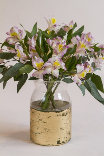 Add your main flowers to the vase, taking care to create a rounded shape.