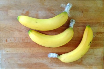 Wrap banana stems to slow down ripening.