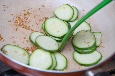 Move the zucchini slices around in the pan as you cook them.