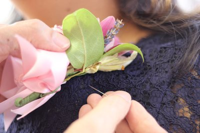 You may need two pins to hold the corsage in place.