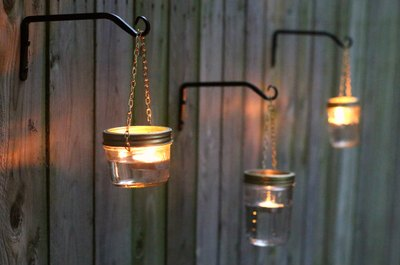 Make your own outdoor lights with mason jars, chain and plant hangers