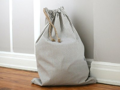 Store the bag in a laundry room, use as a hamper or to carry to the laundromat.