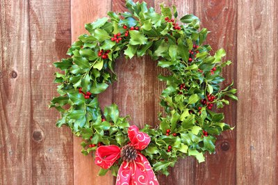 Hang the holly wreath inside or outside.