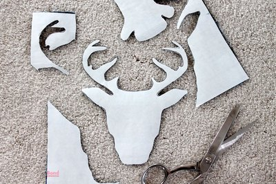 Cut out the deer head silhouette.