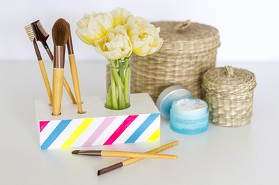 Make your own countertop makeup brush organizer.