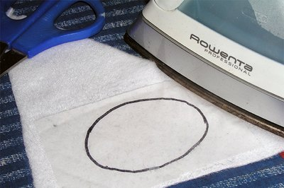 Pressure and heat bond the fusible web to the fabric.